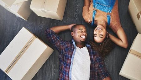 Couple laying with moving boxes